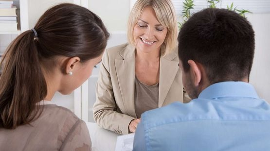 A mortgage broker talking to a client.